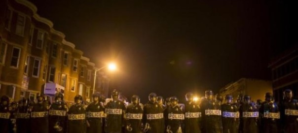 Police line up shortly after the deadline for a city-wide curfew at North Ave and Pennsylvania Ave in Baltimore, Maryland April 30, 2015. REUTERS/Eric Thayer